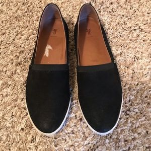 Frye slip-on shoes, black and white.